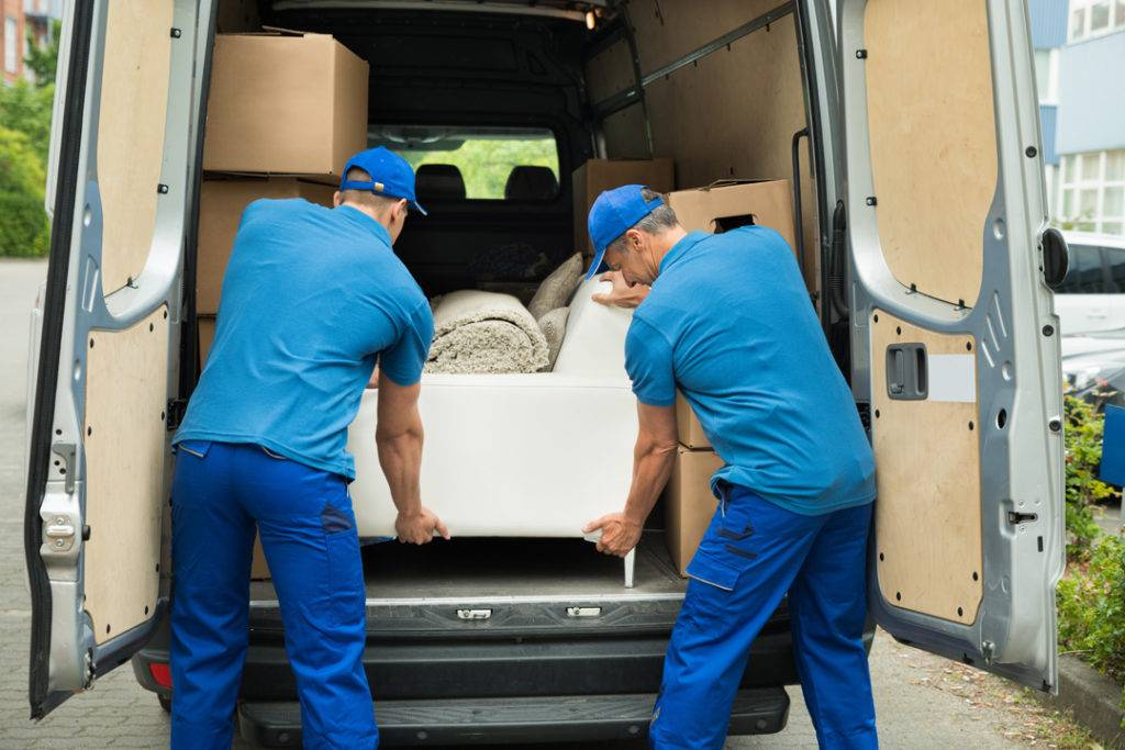 Two employees taking organising the back on a moving van